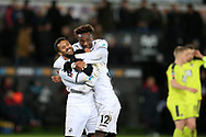 Wayne Routledge of Swansea city celebrates with teammates Tammy Abraham and Nathan Dyer (12) after he scores his teams 6th goal. The Emirates FA Cup, 4th round replay match, Swansea city v Notts County at the Liberty Stadium in Swansea, South Wales on Tuesday 6th February 2018.<br /> pic by  Andrew Orchard, Andrew Orchard sports photography.