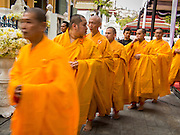12 DECEMBER 2013 - BANGKOK, THAILAND: Thai-Chinese Mahayana Buddhist Monks file out of a chanting service during a mourning service for the Supreme Patriarch of Thailand in a  at Wat Bowon Niwet in Bangkok. Somdet Phra Nyanasamvara, who headed Thailand's order of Buddhist monks for more than two decades and was known as the Supreme Patriarch, died Oct. 24 at a hospital in Bangkok. He was 100. He was ordained as a Buddhist monk in 1933 and rose through the monastic ranks to become the Supreme Patriarch in 1989. He was the spiritual advisor to Bhumibol Adulyadej, the King of Thailand when the King served as monk in 1956. There is a 100 day mourning period for the Patriarch, the service Thursday, on the 50th day, included members of the Thai Royal Family. Although the Patriarch was a Theravada Buddhist, he was the Supreme Patriarch of all Buddhists in Thailand, including the Mahayana sect, which is based in Chinese Buddhism.     PHOTO BY JACK KURTZ