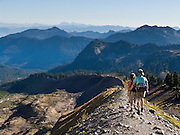 Blue ridges roll south of the Railroad Grade trail on Mount Baker. Hikers can explore great alpine scenery in Mount Baker Wilderness, Mount Baker-Snoqualmie National Forest, Washington, USA