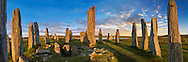Calanais Standing Stones central stone, at sunset,  circle erected between 2900-2600BC measuring 11 metres wide. At the centre of the ring stands a huge monolith stone 4.8 metres high weighing about 7 tonnes, which is perfectly orientated so that its widest sides face due north south. Calanais Neolithic Standing Stone (Tursachan Chalanais) , Isle of Lewis, Outer Hebrides, Scotland. .<br /> <br /> Visit our SCOTLAND HISTORIC PLACXES PHOTO COLLECTIONS for more photos to download or buy as wall art prints https://funkystock.photoshelter.com/gallery-collection/Images-of-Scotland-Scotish-Historic-Places-Pictures-Photos/C0000eJg00xiv_iQ<br /> '<br /> Visit our PREHISTORIC PLACES PHOTO COLLECTIONS for more  photos to download or buy as prints https://funkystock.photoshelter.com/gallery-collection/Prehistoric-Neolithic-Sites-Art-Artefacts-Pictures-Photos/C0000tfxw63zrUT4