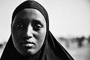 A black and white portrait of an Islamic girl wearing an hijab, Lake Turkana, Loiyangalani,Kenya, Africa