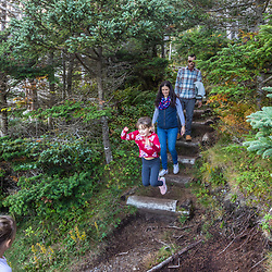 A family walks on a trail at Quoddy Head State Park in Lubec, Maine.