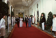 President Ronald Reagan and First Lady Nancy Reagan and President Sadat and wife, Jehan Al Sadat walk down the Grand Hall toward the State Dining Room a state dinner for Anwar Sadat in August 1981,..Photograph by Dennis Brack bb24