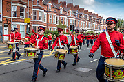 The Pride Of Ardoyne Flute Band of North Belfast parading through the streets of Belfast during the Orange March, 2021