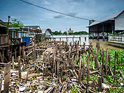 16 AUGUST 2017 - BANGKOK, THAILAND: All that is left of some of the homes after city officials tore down several homes built on pilings in the Wat Thewarat Kunchorn community. The community is one of the 14 riverside communities that will be torn down to make way for a riverfront promenade. Construction of the 14 kilometer long promenade will start in late 2017.           PHOTO BY JACK KURTZ