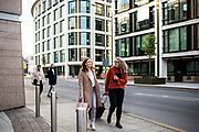 Business women walking to work in the offshore business and finance centre of St Helier, Jersey, CI