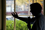 A silhouette of Alexander Pechtold, leader of the Dutch Liberal Democratic Party (D66), debating students of the Praedinius Gymnasium in Groningen // Silhouet van Alexander Pechtold (D66), in debat met scholieren van het Praedinius Gymnasium in Groningen.