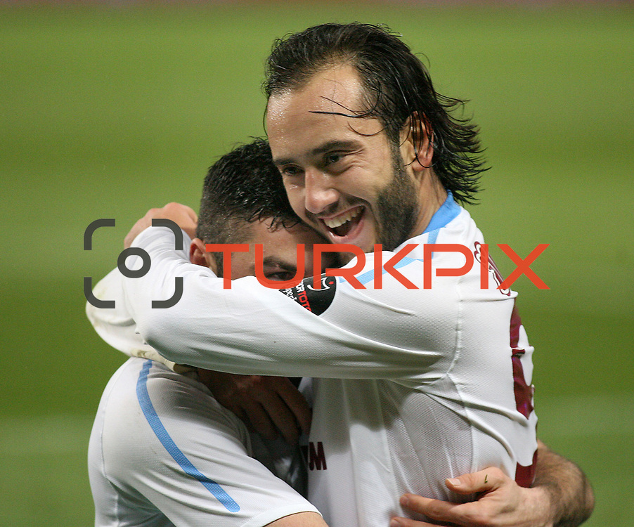 Trabzonspor's Burak Yilmaz (L) celebrate his goal with team mate during their Turkish soccer superleague match IBBSpor between Trabzonspor at the Ataturk Olympic stadium in Istanbul Turkey on Saturday 07 January 2012. Photo by TURKPIX
