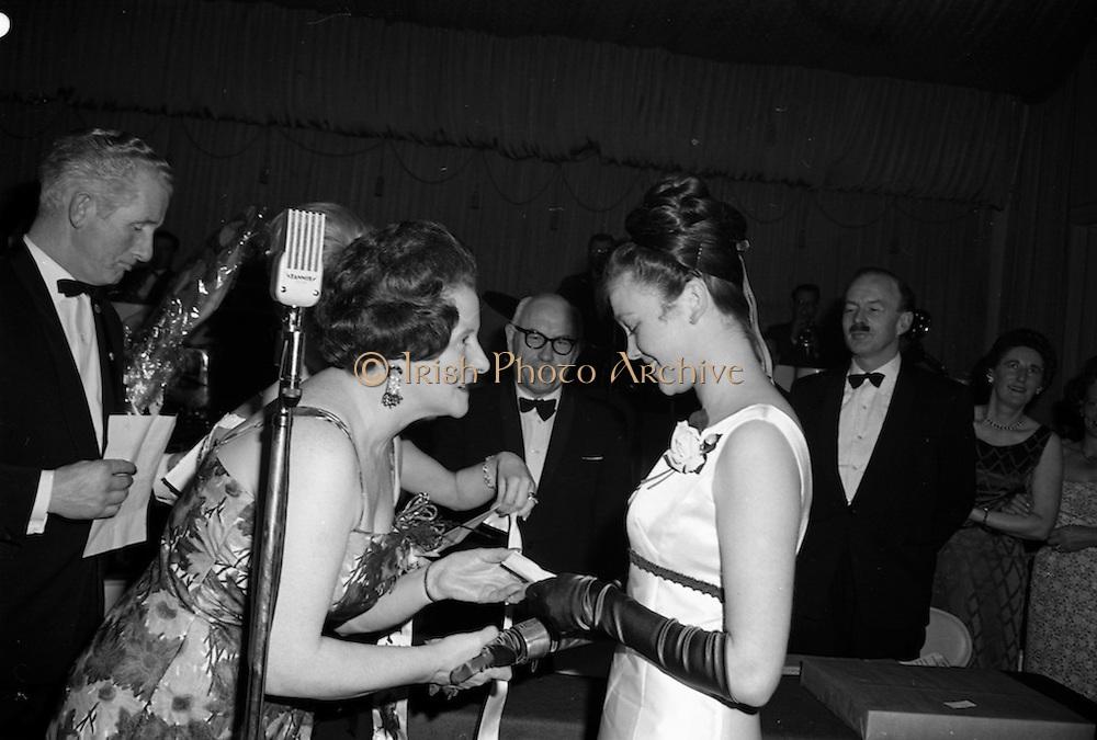 8/04/1965<br /> 04/28/1965<br /> 28 April 1965<br /> Festival of Kerry Dublin Ball at the Gresham Hotel, Dublin. Photo shows winner Miss Irene Courtney (right) receiving her award from Frances McDermott (hidden) and Mrs Nanette Barrett, Chairman, Dublin Committee.