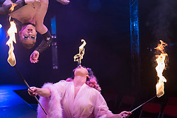"""© Licensed to London News Pictures. 24/04/2019. LONDON, UK. (L to R) Beau Sargent (aerial contortionist) and Kitty Bang Bang (fire breathing bearded lady) at the preview of Bernie Dieter's """"Little Death Club"""" an eclectic performance show taking place at the Underbelly Festival on the Southbank until 23 June 2019.  Photo credit: Stephen Chung/LNP"""