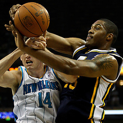 April 11, 2011; New Orleans, LA, USA; New Orleans Hornets power forward Jason Smith (14) and Utah Jazz power forward Derrick Favors (15) battle for a rebound during the first half at the New Orleans Arena.  Mandatory Credit: Derick E. Hingle