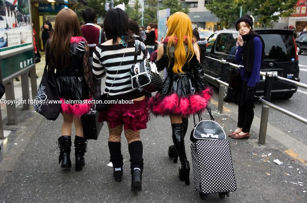 Young Japanese girls dressed in Cosplay theme walking in Harajuku Tokyo JApan