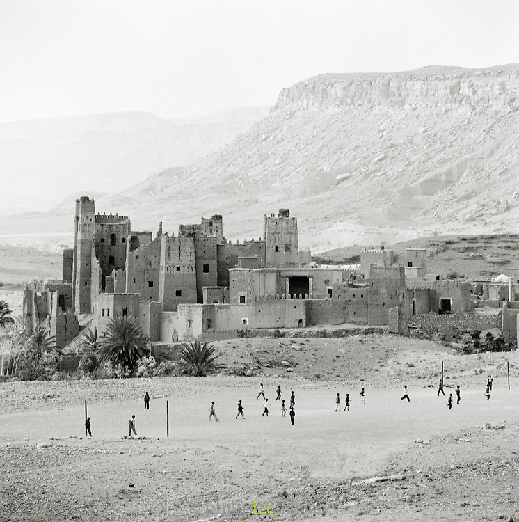 People playing football in front of Kasbah Ait Benhaddou in Ouarzazate, Morocco