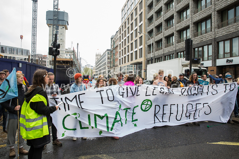 London, UK. 24th April 2019. Climate change activists from Extinction Rebellion block Victoria Street on the tenth day of the International Rebellion to call on the British government to take urgent action to counter climate change.