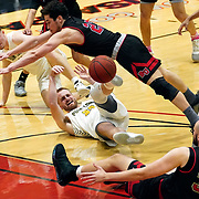 Point Loma forward Noah Stapes (23) passes the ball after picking up a loose ball as Biola guard Whitten Dominguez (23) dives trying for the  steal during the the PacWest basketball championship finals in the Felix Event Center at Azusa Pacific University Saturday, March, 7, 2020, in Azusa. (Mandatory Credit: Christina Leung-Sports Shooter Academy)
