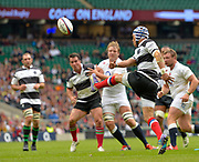 Barbarians full-back Gio Aplon (Grenoble & South Africa) puts in a clearing kick during the International Rugby Union match England XV -V- Barbarians at Twickenham Stadium, London, Greater London, England on May  31  2015. (Steve Flynn/Image of Sport)