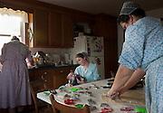 Old order Mennonite family making cookies for Christmas