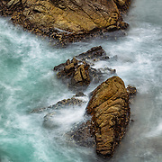 Rocks off the coast surrounded by the swirling incoming tide, Point Lobos State Preserve