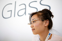 A Google employee wears a pair of the Google Project Glass, a wearable personal computer device,  during the Google I/O Developer Conference in San Francisco, California.
