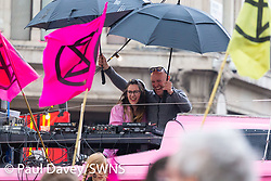 An impromptu rave is held with DJs aboard a yacht sheltering from the threatening rain as hundreds of environmental protesters from Extinction Rebellion occupy Oxford Circus, a pink yacht being the focal point of their presence, with traffic denied access to two of London's busiest streets. London, April 16 2019.