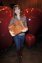 CHARLOTTE RILEY at a party to celebrate the launch of the new Mulberry leather case for Apple's iPhone held at the Mulberry store, Bond Street, London on 5th November 2009.