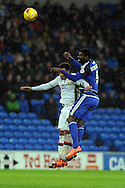 Cardiff City's Bruno Ecuele Manga (r) heads away from M K Dons Nicky Maynard. Skybet football league championship match, Cardiff city v MK Dons at the Cardiff city stadium in Cardiff, South Wales on Saturday 6th February 2016.<br /> pic by Carl Robertson, Andrew Orchard sports photography.