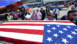 April 4, 2017 - Tampa, Florida, U.S. - The flag draped casket containing the remains of Mark Dennis is carried by Patriot Guard members as his sisters Eileen Brady, 80, of Largo, back right, and Anne Moline, 74, of Arvada, Colorado back left look on Tuesday, April 04, 2017 at Tampa International Airport. The remains of their brother Mark Dennis arrived via  Southwest Airlines Tuesday. The remains returned to Tampa Bay eight months after the military concluded for the fourth time that they belonged to Dennis. The first time was in July, 1966, just days after Dennis, a Navy Hospital Corpsman 3rd Class, was in a helicopter shot down in Vietnam, making him the first casualty of the war from his small town south of Dayton, Ohio. (Credit Image: © Chris Urso/Tampa Bay Times via ZUMA Wire)