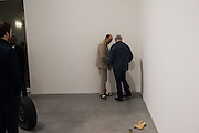 GAVIN TURK; DAMIEN HIRST, checking the crushed can exhibit, Gavin Turk: Who What When Where How & Why. Newport St. Gallery. London. 22 November 2016