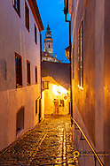 Castle Tower through narrow cobblestone streets in historic Cesky Krumlov, Czech Republic