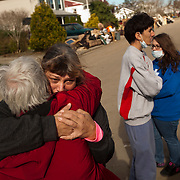 """Vicki Hagman hugs her sister Judy as Judy takes away her dogs on a street littered with debris and wreckage left by Superstorm Sandy in Union Beach NJ, The storm destroyed Vicki's home, forcing her to move in with another sister: """"We have six people and four dogs staying in a small house. It was too much. I have to send them away."""" she said, barely holding back tears.The storm-surge from Superstorm Sandy destroyed several oceanfront blocks of Union Beach, leveling homes or lifting them off their foundations, breaking them apart and moving them."""