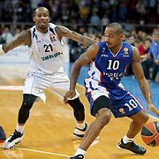Anadolu Efes's Dontaye Draper (R) and Nizhny Novgorod's Tarence Kinsey (L) during their Turkish Airlines Euroleague Basketball Group A Round 9 match Anadolu Efes between Nizhny Novgorod at Abdi ipekci arena in Istanbul, Turkey, Friday December 12, 2014. Photo by Aykut AKICI/TURKPIX