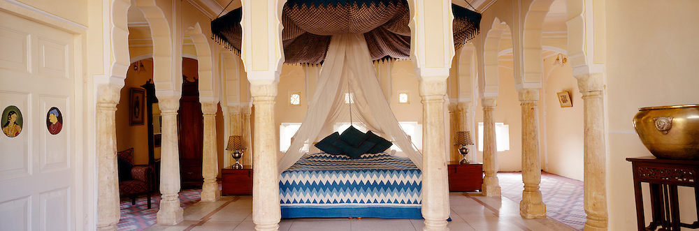 Bedroom Interior at the Samode Palace Hotel. The Samode Palace originally was built in the 19th century as a private residence of the Samode Royal Family. It is an example of Rojput-Mohghul architecture. Samode, Rajasthan, Jaipur, India