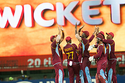 © Licensed to London News Pictures. 07/10/2012. The West Indian team celebrate after getting a wicket during the World T20 Cricket Mens Final match between Sri Lanka Vs West Indies at the R Premadasa International Cricket Stadium, Colombo. Photo credit : Asanka Brendon Ratnayake/LNP