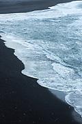 Black volcanic sand beach Reynisfjara with dangerous tides near the village Vík i Myrdal, South Iceland