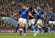 Matthew Upson clears the ball from Christian Benteke during the The FA Cup match between Aston Villa and Leicester City at Villa Park, Birmingham, England on 15 February 2015. Photo by Alan Franklin.