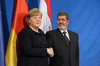 DEU, Deutschland, Germany, Berlin, 30.01.2013:<br />Ägyptens Präsident Mohammed Mursi (R) und Bundeskanzlerin Angela Merkel (L) (CDU) nach einer Pressekonferenz im Bundeskanzleramt.