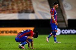 Andros Townsend and Joel Ward of Crystal Palace cut dejected figures after defeat to Wolverhampton Wanderers - Mandatory by-line: Robbie Stephenson/JMP - 20/07/2020 - FOOTBALL - Molineux - Wolverhampton, England - Wolverhampton Wanderers v Crystal Palace - Premier League