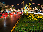 02 DECEMBER 2014 - BANGKOK, THAILAND: Traffic on Ratchdamnoen Ave in Bangkok, Ratchdamnoen Ave is one of the main streets in Bangkok and connects the Grand Palace to the Dusit Palace. It is lit up for the King's Birthday, which is Dec. 5. The King's Birthday honors Bhumibol Adulyadej, the King of Thailand, and is a national holiday in Thailand.    PHOTO BY JACK KURTZ