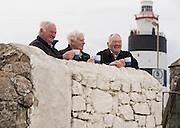 """REPRO FREE. 07/04/2013. Hook Lighthouse Keepers. Former lighthouse keepers of Hook Lighthouse are brothers Nicholas and Tux Tweedy and Martin Murphy announce the 'Calling all Lighthouse Keepers' Gathering at the world's oldest intact operational lighthouse, Hook Lighthouse in county Wexford to take place this September. Picture: Patrick Browne<br /> <br /> FREE TO USE IMAGES – Patrick Browne – 086 251 5700<br /> <br /> Sunday, April 7, 2013.<br /> For immediate release<br />  <br /> Shining a Light on Lighthouse Keepers at Hook Lighthouse Gathering<br />  <br /> Hook Lighthouse today (Sunday, April 7) announced a flagship Gathering Ireland event 'Calling all Lighthouse Keepers' which will take place at the world's oldest operational lighthouse this September 13 to 15 on the Hook Peninsula in county Wexford.<br /> <br /> A small gathering of some of the past Lighthouse keepers took place today at Hook Lighthouse to discuss plans for the upcoming occasion and to invite lighthouse keepers and enthusiasts from across the globe to this unique event.<br /> <br /> The 800-year-old lighthouse has a great history, it was built by William Marshal, Earl of Pembroke in the early 13th Century to guide ships safely around Hook Peninsula and has been attended by over 100 lighthouse keepers since around 1810 with the last keeper Tweedy, T.P. (Tux) keeping watch from 1990 to 1996 and currently attending the lighthouse which is automated with its' beacon rotating 24 hours a day 365 days of the year.<br />  <br /> Commenting on the plans for the gathering event. Hook Lighthouse Manager Ann Waters said, """"We are really excited about this event, it is something we have been working on for sometime with the Commissioners of Irish Lights. Hook Lighthouse is described as """"the grand-daddy of all lighthouses"""" so where else could you hold a gathering for lighthouse keepers, their families, enthusiasts and societies from all over the world, there has been huge interest in the event so far with """