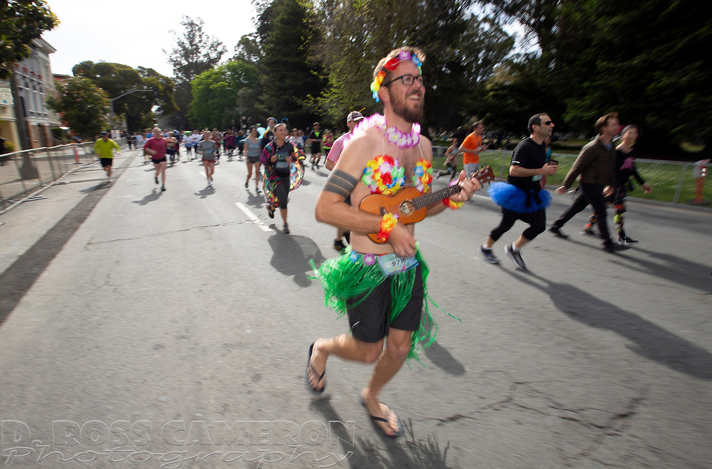 A San Francisco man entertains the crowd with ukulele music on the way up Fell Street at the 107th running of the Bay to Breakers, Sunday, May 20, 2018, in San Francisco. (Photo by D. Ross Cameron)