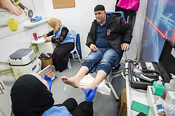 26 February 2020, Abu Dis, Palestine: Nurse Najwa Hawamdeh administers a foot exam of patient 49-year-old Diabetes patient Issam Muhsan from Abu Dis, while nurse Amal Abu-Ghanam takes notes. The testing is an annual routine for Diabetes patients. In an effort to make Diabetes services more accessible to people in the West Bank, the Augusta Victoria Hospital offers a Mobile Diabetes Clinic, which moves around to various locations in the West Bank, offering screening and routine testing for Diabietes and the symptoms it causes.