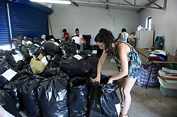 LEIRIA, June 20, 2017  Volunteers sort out relief supplies at the relief center in Avelar near Leiria, some 200 km northeast of Lisbon, Portugal, on June 19, 2017. By Monday, 64 people including a young fire fighter were killed and 135 others were injured in the fires which erupted in Pedrogao Granda on Saturday and quickly spread into neighboring towns, making it the biggest tragedy in Portugal in more than four decades, as President Marcelo Rebelo de Sousa stated.  gj) (Credit Image: © Zhang Liyun/Xinhua via ZUMA Wire)