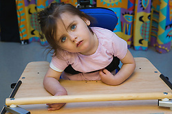 Young girl with severe leaning disabilities in a lesson,