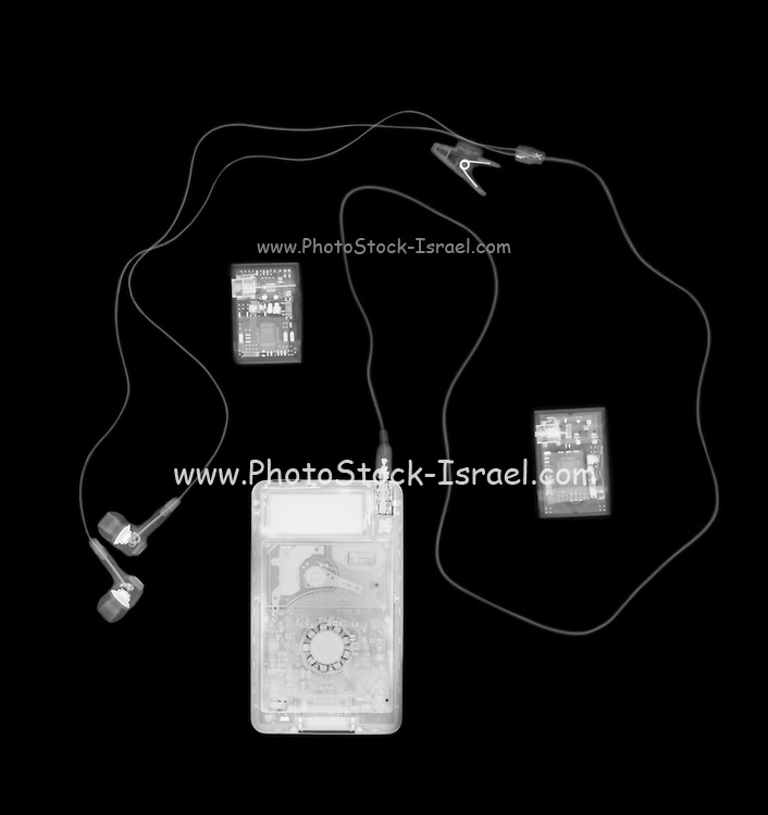 X-ray photography of a Ipod and earphones