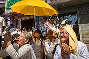 """04 FEBRUARY 2013 - PHNOM PENH, CAMBODIA: Mourners sit on the street in front of the National Museum during the cremation of King-Father Norodom Sihanouk in Phnom Penh. Norodom Sihanouk (31 October 1922- 15 October 2012) was the King of Cambodia from 1941 to 1955 and again from 1993 to 2004. He was the effective ruler of Cambodia from 1953 to 1970. After his second abdication in 2004, he was given the honorific of """"The King-Father of Cambodia."""" Sihanouk died in Beijing, China, where he was receiving medical care, on Oct. 15, 2012.    PHOTO BY JACK KURTZ"""
