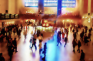 An image of the interior of Grand Central Station, full of commuters and light, a very impressionistic image.