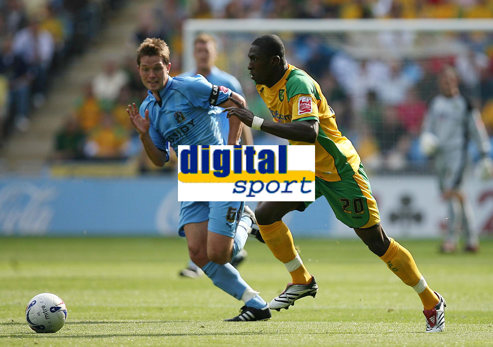 Photo: Rich Eaton.<br /> <br /> Coventry City v Norwich City. Coca Cola Championship. 09/09/2006. Dickson Etuhu right of Norwich tries to get past Coventry captain Stephen Hughes
