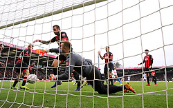 Brighton & Hove Albion's Florin Andone (hidden) scores his side's third goal of the game during the Emirates FA Cup, third round match at the Vitality Stadium, Bournemouth.