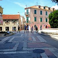 Pedestrians and tourists in a square.<br />Split, Croatia. 2018