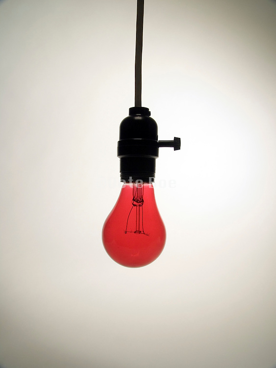 hanging bare red light bulb in socket